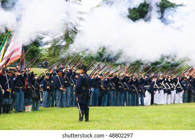 PORT GAMBLE, WA - JUN 20:    Union infantry line fires a volley during a mock Civil War battle  on Jun 20, 2009 in Port Gamble WA