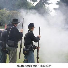 PORT GAMBLE, WA - JUN 20:    Union infantry skirmishers hold their position during a mock Civil War battle  on Jun 20, 2009 in Port Gamble WA
