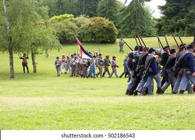 PORT GAMBLE, WA - JUN 20  - Union Civil War reenactors marching during a mock battle Port Gamble WA on Jun 20, 2009.