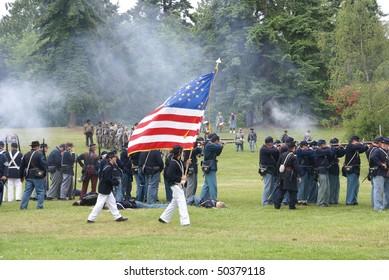 PORT GAMBLE, WA - JUN 20  - Union color guard displays the flag during a mock battle  on Jun 20, 2009  at Port Gamble WA