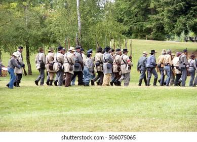 PORT GAMBLE, WA - JUN 20  - Confederate Civil War reenactors marching during a mock battle Port Gamble WA on Jun 20, 2009.