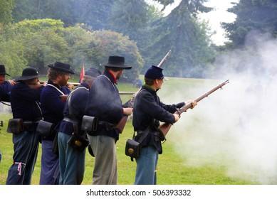PORT GAMBLE, WA - JUN 20  - Civil War reenactors participate in a mock battle on Jun 20, 2009. Union infantry line firing a volley.