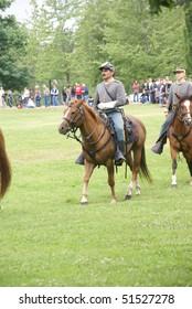 PORT GAMBLE, WA - JUN 20  -  Confederate cavalry patrols the field during a mock Civil War battle on Jun 20, 2009in Port Gamble WA