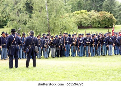 PORT GAMBLE, WA - JUN 20  - Union infantry form a line for review after a mock Civil War battle at Port Gamble WA on Jun 20, 2009.