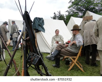 PORT GAMBLE, WA - JUN 20  - A sutler and his wife relax by their tent in the Confederate camp during a Civil War Battle Re-enactment, on Jun 20, 2009, in Port Gamble, WA.