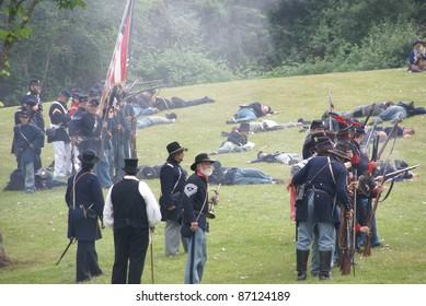 PORT GAMBLE, WA - JUN 20  -  Union infantry maneuvers during a mock Civil War battle on Jun 20, 2009in Port Gamble WA.