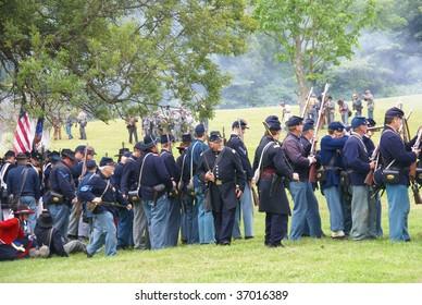 PORT GAMBLE, WA - JUNE 20 : Union and Confederate Civil War reenactors skirmish in a mock battle June 20, 2009 in Port Gamble, WA.