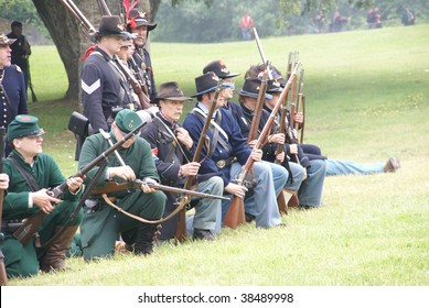 PORT GAMBLE, WA - JUNE 20 : Green jacketed Union sharpshooters load and fire their rifles during a mock Civil War battle on June 20, 2009 in Port Gamble, WA.