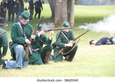 PORT GAMBLE, WA - JUNE 20: Green jacketed Union sharpshooters load and fire their rifles during a mock Civil War battle on June 20, 2009 in Port Gamble, WA.