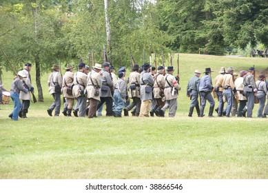 PORT GAMBLE, WA - JUNE 20 : Confederate Civil War reenactors march during a mock battle on Jun 20, 2009 in Port Gamble, WA.