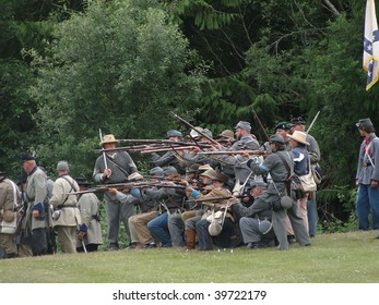 PORT GAMBLE, WA - JUNE 20 : Confederate Civil War reenactors fire  their weapons during a mock battle on June 20, 2009 in Port Gamble, WA.