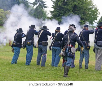 PORT GAMBLE, WA - JUNE 20 : Union infantry line fires a volley during a mock Civil War battle on June 20, 2009 in Port Gamble, WA.