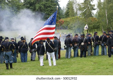 PORT GAMBLE, WA - JUNE 20  : Union color guard displays the flag during a mock battle  on June 20, 2009  in Port Gamble WA