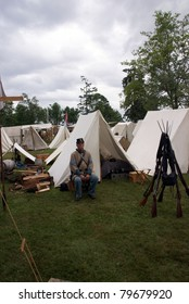 PORT GAMBLE, WA - JUNE 20 : A Confederate sergeant waits by his tent before battle, during a Civil War Battle Re-enactment on June 20, 2009 in Port Gamble, WA.