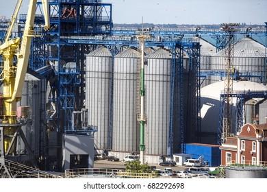 Port grain elevator. Industrial sea trading port bulk cargo zone grain terminal