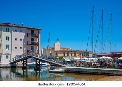 PORT GRIMAUD, FRANCE - JUNE 04, 2013: Cityscape with the church Saint-Francois-d´Assise in  Port Grimaud in the Department Var of the province Provence-Alpes-Cote d´Azur