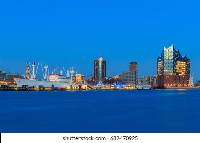 Port of Hamburg with museum-ship and Elbphilharmonie during blue hour at early evening