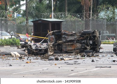 PORT HARCOURT, NIGERIA - DECEMBER 20. Remains of a car bomb on Dec 20, 2006 inside the residential area of a major oil company. Expatriate oil worker families are evacuated from the city soon after.
