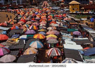 Port Harcourt, Nigeria - November 10, 2020: Mile I market, a crowded marketplace in Port Harcourt City with structures consisting mostly of colourful umbrellas serving as shade and space for traders.