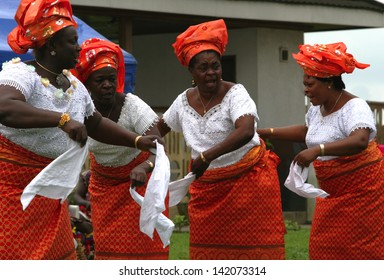PORT HARCOURT, NIGERIA - OCTOBER 2 - Igbo women are performing a traditional dance with white handkerchiefs as part of Independence Day celebrations in the city of Port Harcourt on October 2, 2005.