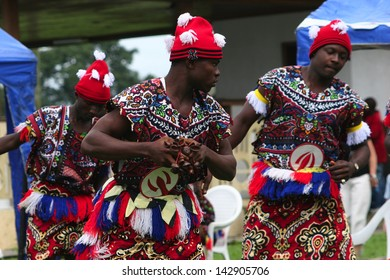 PORT HARCOURT, NIGERIA - OCTOBER 2 - Igbo men are performing a traditional dance as part of Independence Day celebrations in the city of Port Harcourt on October 2, 2005.