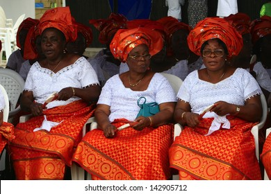 PORT HARCOURT, NIGERIA - OCTOBER 2 - Igbo women in bright attire waiting to perform a traditional dance as part of Independence Day celebrations in the city of Port Harcourt on October 2, 2005.