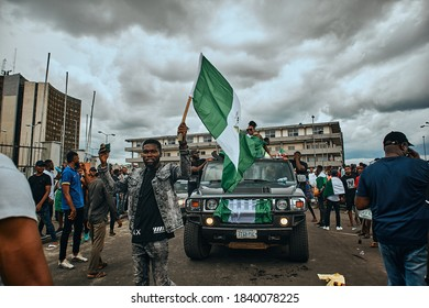 Port Harcourt, Nigeria - October 20, 2020: Protesters walking around the city of Port Harcourt raising placards and signs for the #Endsars protests in Nigeria.