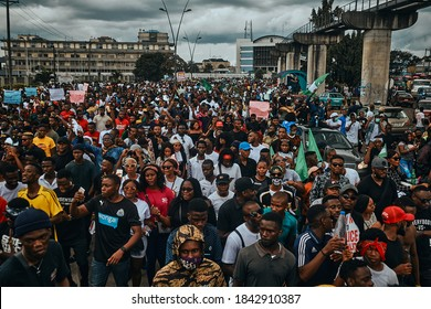Port Harcourt, Nigeria - October 20, 2020:  Crowd of protesters walking around the city of Port Harcourt raising placards and signs for the #Endsars protests in Nigeria.