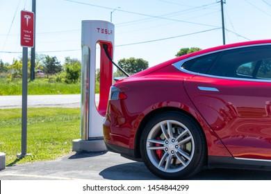 PORT HOPE, CANADA - June 7, 2019: Shining Tesla Model S seen while charging at Tesla Supercharger Station.