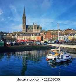 Port, houses and Cathedral in Cobh, Ireland. Famous city and popular touristic destination