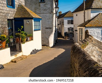 Port Isaac, Cornwall, UK – 4 26 2021: Fore Street in Port Isaac, a  fishing village in Cornwall, UK, and popular location for TV dramas 'Poldark', 'Doc Martin' and feature film 'Fisherman's Friends'.