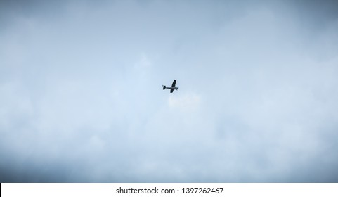 Port Joinville, France - September 16, 2018: Small passenger plane flying over Isle of Yeu near France on a fall day