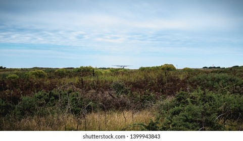Port Joinville, France - September 16, 2018 small plane that maneuver on an airfield in the island of Yeu near France an autumn day