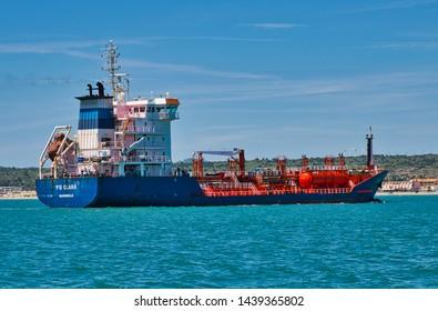 Port La Nouvelle, Aude/France - June 8th 2019: Coastal cargo ship FS Clara entering the small port of Port la Nouvelle on the French Mediterranean coast