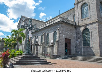 Port Louis, Mauritius - 18 April, 2018: Statue of Jesus on the cross at St. Louis Cathedral