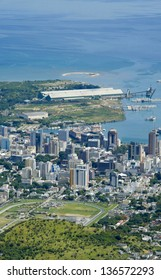 Port Louis Mauritius city skyline over blue sky