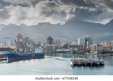 Port Louis, Mauritius - December 25, 2015: Port Louis cityscape Mauritius. Ships in the harbor in foreground. The city is the country's economic, cultural, political centre and most populous city.