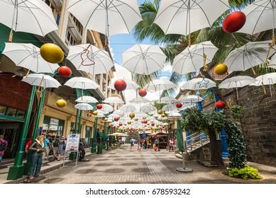 Port Louis, Mauritius - December 25, 2015: Display of white umbrellas in Caudan Waterfront Mall, Port Louis, Mauritius.
