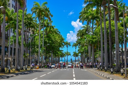 Port Louis, Mauritius - Jan 4, 2017. Main street with palm trees in Port Louis, Mauritius. Port Louis is the country economic, cultural and political centre.