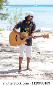 PORT LOUIS, MAURITIUS - MARCH 18, 2017 : African animator plays guitar and dances for tourists. The island of Mauritius is popular with tourists.