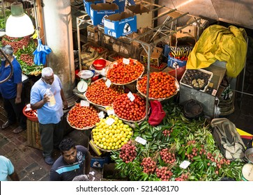 PORT LOUIS, MAURITIUS - NOVEMBER 18, 2016: People shops for fresh fruits and vegetables in the traditional fresh market of Port Louis, Mauritius capital city.