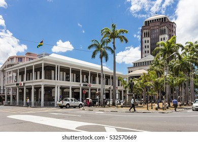 PORT LOUIS, MAURITIUS - NOVEMBER 18, 2016: People walk in the street of Port Louis lined with international banks in Mauritius. The city is an important offshore financial center.