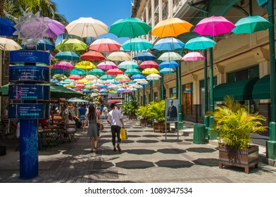 Port Louis, Mauritius - September 22, 2017: unidentified tourists and shoppers enjoy a day out at the Le Caudan Waterfront shopping complex in the city