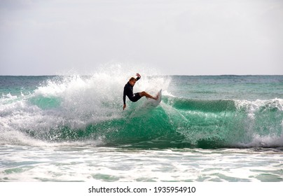 PORT MACQUARIE, AUSTRALIA - FEBRUARY 14, 2021: A surfer performing an aerial on top of a wave.