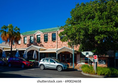 PORT MACQUARIE, NEW SOUTH WALES, AUSTRALIA, JULY 14 2017: City centre street with shops, cafes banks and apartment houses on a sunny day in this coastal holiday town.