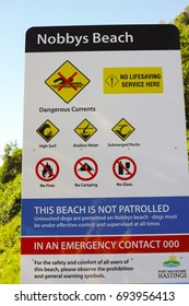 PORT MACQUARIE, NEW SOUTH WALES, AUSTRALIA, 14 JULY 2017: Sign on Nobbys Beach at Port Macquarie Australia listing dangers and forbidden activities.