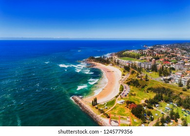 Port Macquarie on Australian NSW pacific coast seen from above around river delta and local beach adjusted to caravan park for tourists.