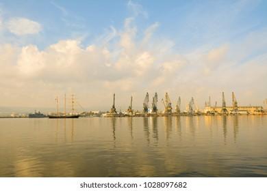 Port. Marine boat. sailer, lighthouse, port cranes, ships.