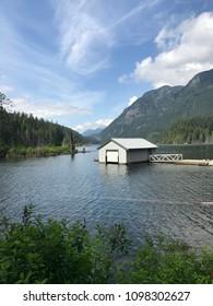 Port Moody, BC, Canada, 2018-05-24: Buntzen Lake, view for mountains, lake treees