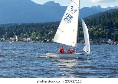 PORT MOODY, BC, CANADA - JUNE 2007: Family enjoying a sail on a summer day in Burrard Inlet, Port Moody, BC
